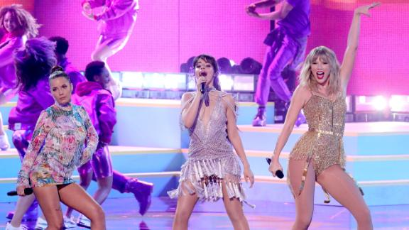 From left, Halsey, Camila Cabello and Taylor Swift perform during the 2019 American Music Awards on Sunday.