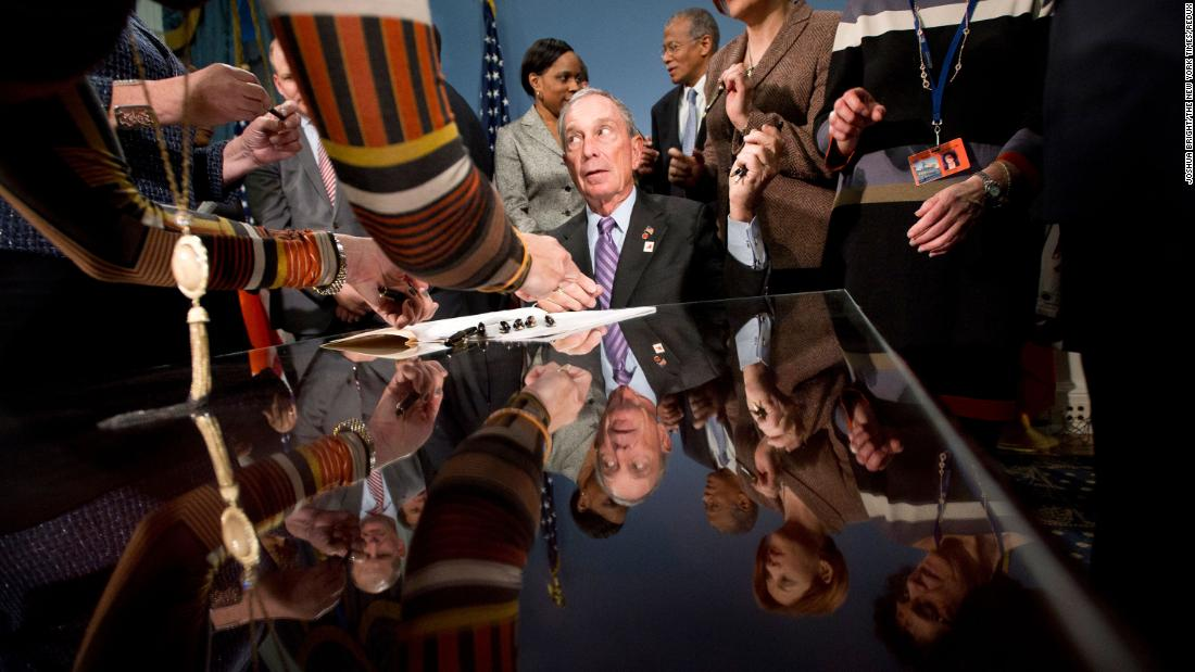 Michael Bloomberg, as New York mayor, attends a bill-signing ceremony in January 2012.