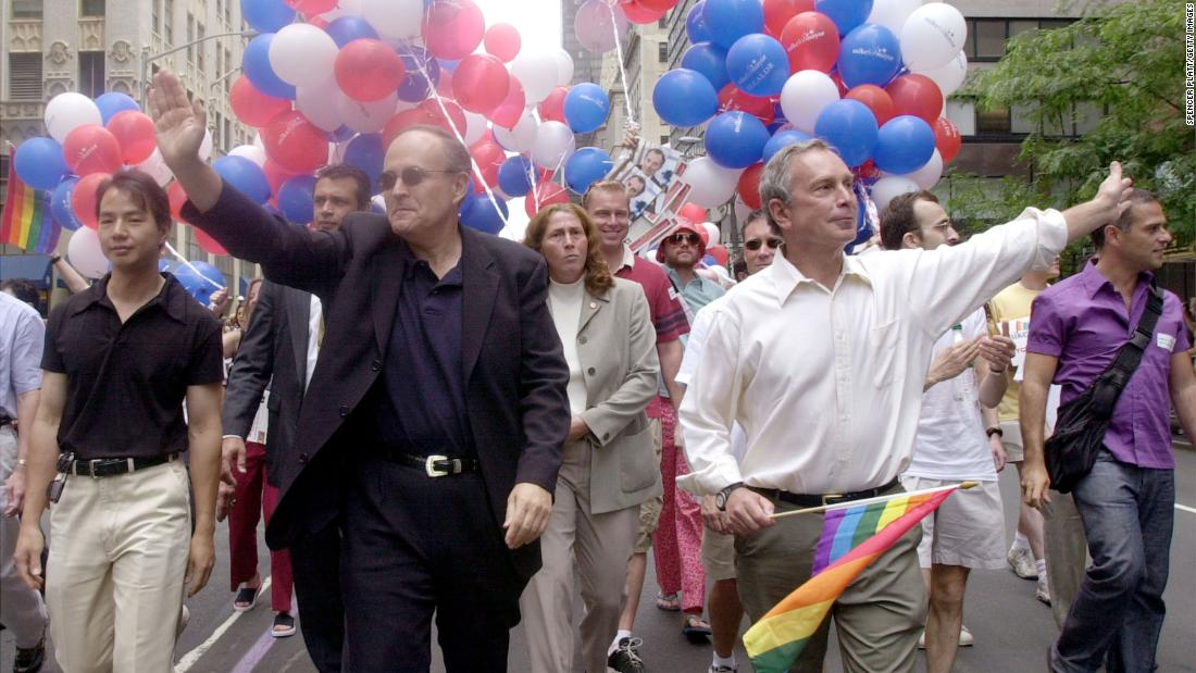 Bloomberg and New York Mayor Rudy Giuliani march in a gay pride parade in June 2001. Giuliani's two terms were just about up. Later that year, Bloomberg was elected as his successor.