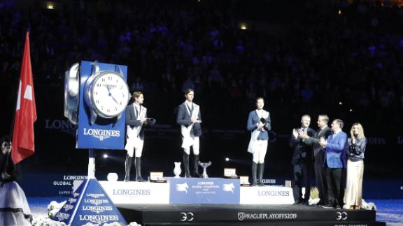 To cap a stellar season, Briton Ben Maher (center) adds the Super Grand Prix crown to his second straight Longines Global Champions Tour title.