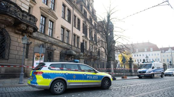 A police car stands in front of the cordoned off Royal Palace that houses the historic Green Vault (Gruenes Goelbe) in Dresden, eastern Germany on November 25, 2019, after it was broken into. - A state museum in Dresden containing billions of euros worth of baroque treasures has been robbed, police in Germany confirmed on November 25, 2019. The Green Vault at Dresden