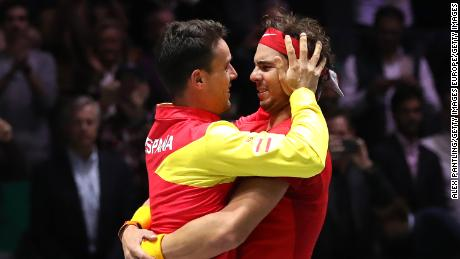 Rafael Nadal embraces teammate Roberto Bautista Agut, whose father passed away during the Davis Cup last week.
