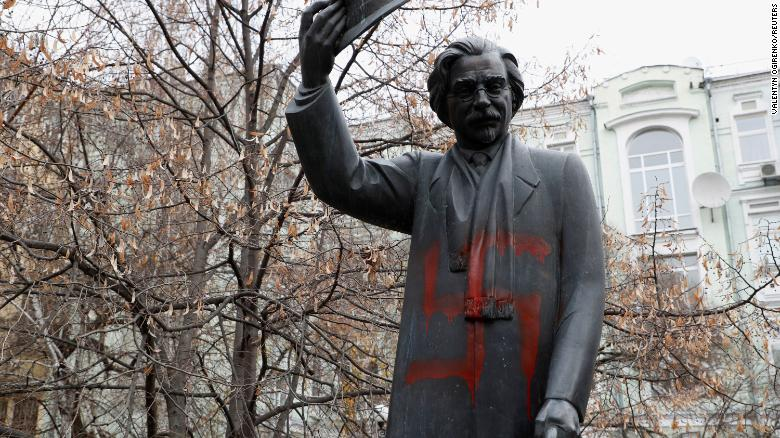 A monument to Yiddish author Sholem Aleichem is seen vandalized with swastikas in Kiev, Ukraine