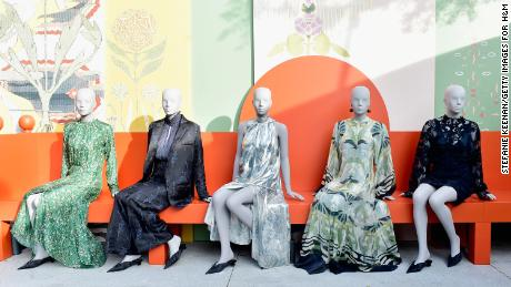 H&M displays dresses from its 2018 Conscious Exclusive collection. The retailer wants to be seen as a climate champion — but that sustainability mission is in direct tension with its fast fashion business model. (Stefanie Keenan/Getty Images for H&M)