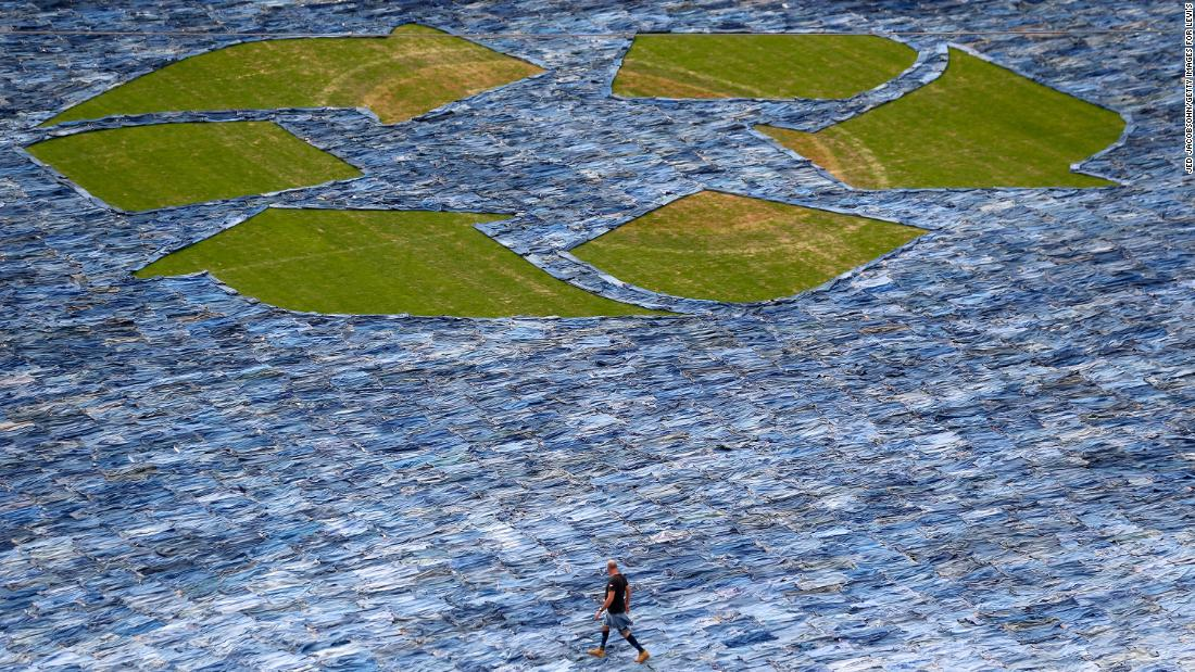 In an effort to encourage people to donate clothing rather than toss it aside, Levi Strauss & Co. displayed 19,000 pairs of jeans at a stadium in 2014. (Jed Jacobsohn/Getty Images for Levi's)