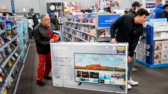 CHICAGO, IL - NOVEMBER 22: Shoppers carry a flat screen TV through a Best Buy Inc. store on November 22, 2018 in Chicago, Illinois. Known as 'Black Friday', the day after Thanksgiving marks the beginning of the holiday shopping season, with many retailers opening their doors on Thursday evening. (Photo by Kamil Krzaczynski/Getty Images)