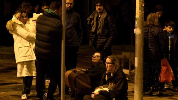 Residents gather in Tirana after the quake struck.