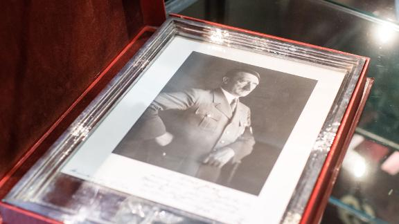 A framed portrait of Adolf Hitler is pictured on November 20, 2019 at the «Hermann Historica» auction house in Grasbrunn near Munich, southern Germany, prior to an auction of personal belongings from German dictator Adolf Hitler and other notorious World War II Nazi leaders. - An auction of Nazi memorabilia, including Adolf Hitler's top hat, raked in hundreds of thousands of euros in Munich Wednesday, November 20, 2019, in the teeth of German and international protest. The hammer fell on the Nazi leader's top hat at 50,000 euros ($55,310), according to the Hermann Historica auction house website, while items of clothing belonging to his partner Eva Braun each sold for thousands. (Photo by Matthias Balk / dpa / AFP) / Germany OUT (Photo by MATTHIAS BALK/dpa/AFP via Getty Images)