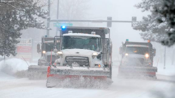 Denver residents faced snow-packed roads and flight delays Monday and Tuesday.