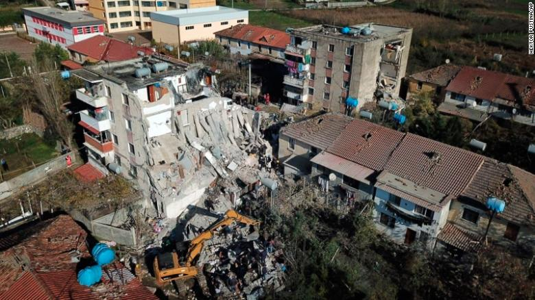 Rescuers search a damaged building in Thumane, Albania, after an earthquake on Tuesday, November 26.