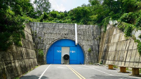Outside the innovative tunnel farm.