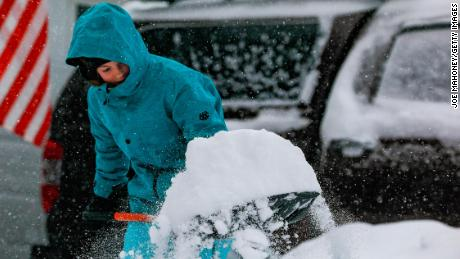 Jordan Dickman, 17, shovels some of the 11 inches of snow that fell on Denver on November 26.