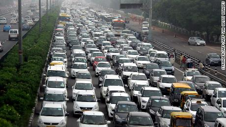 Traffic stretches back in Hero Honda chowk as waterlogging during monsoon downpours causes traffic jams in Gurgaon on July 29, 2016. Thousands of Indians were left stranded overnight July 29, as major traffic gridlock paralysed roads leading to a key business city near New Delhi and authorities struggled to get the situation under control. / AFP / STRINGER(Photo credit should read STRINGER/AFP via Getty Images)