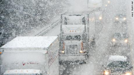 Motorists brave the falling snow as they head south on Interstate 81 near Staunton, Virginia, on November 26, 2014.