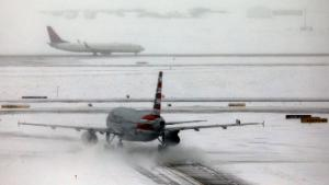An American Airlines jet taxis down a snow-covered runway after a pre-Thanksgiving holiday snowstorm caused more than 460 flight cancellations at Denver International Airport, Colorado, U.S., November 26, 2019. REUTERS/Bob Strong