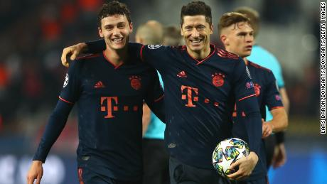 Robert Lewandowski is congratulated by Bayern teammate Benjamin Pavard.