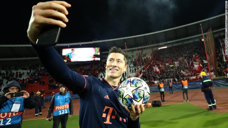 Robert Lewandowski takes a selfie with his match ball after scoring his third hat trick of the season.