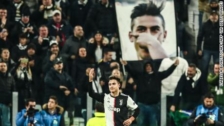 Paulo Dybala celebrates after opening the scoring against Atletico Madrid in the Champions League.
