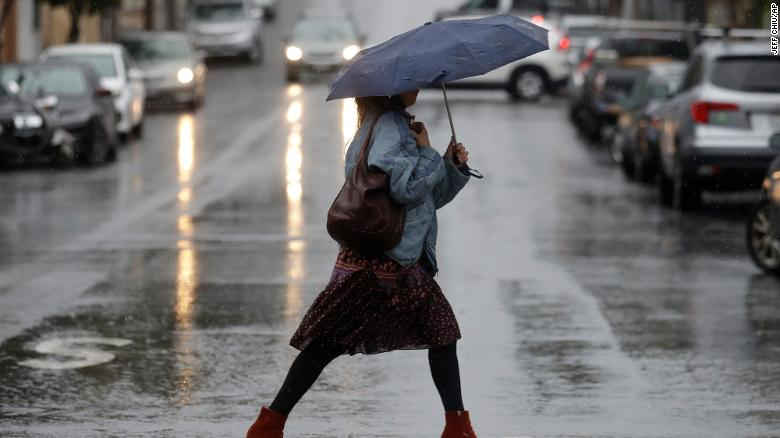 A woman walking in the rain in San Francisco Tuesday