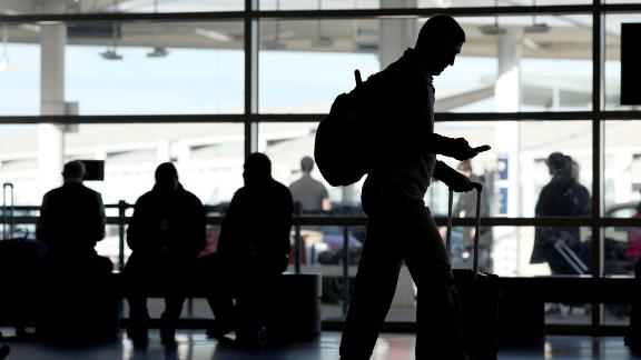 A traveler walks through the Oakland International Airport in Oakland, California.