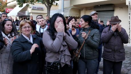 An emotional crowd gathers near a collapsed building in Durres on Tuesday.