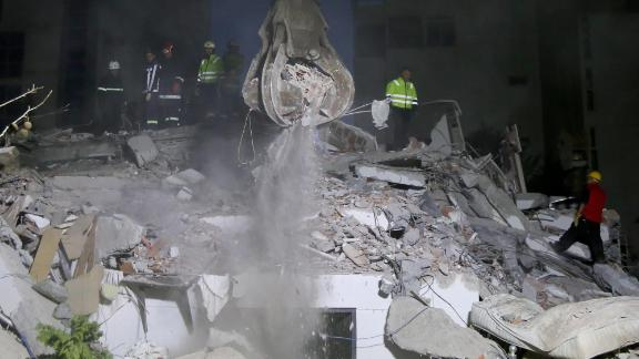 Crews search for survivors in the rubble of a building in Durres on November 26.