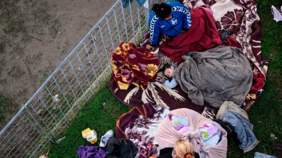 A family shelters at a makeshift camp for earthquake survivors in Durres, Albania, on November 27.
