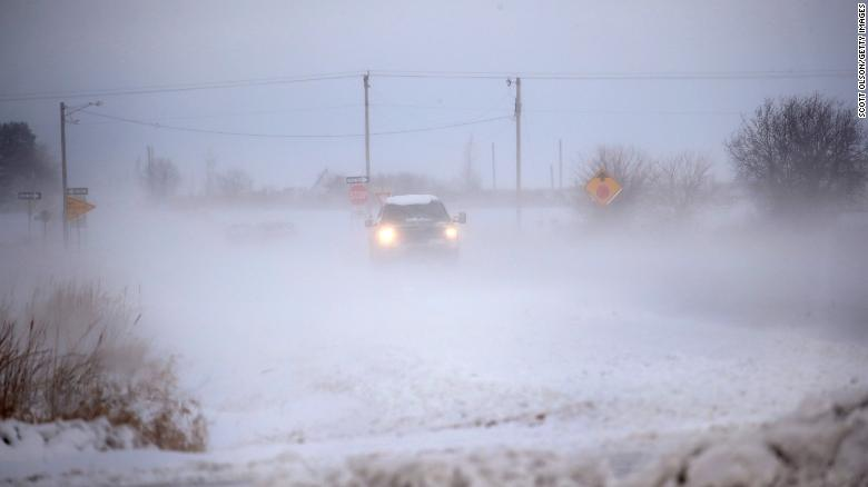 A traveler drives down an ice- and snow-covered road in Mason City, Iowa, on Wednesday.