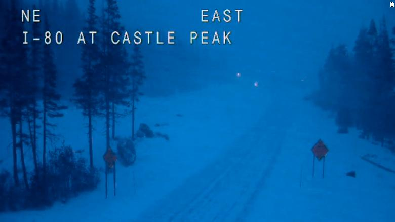 In this still image taken from a Caltrans remote video traffic camera, eastbound Interstate 80 is empty Wednesday morning because of closures and restrictions in Soda Springs, California.