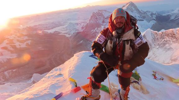 Purja at the summit of Mount Everest.