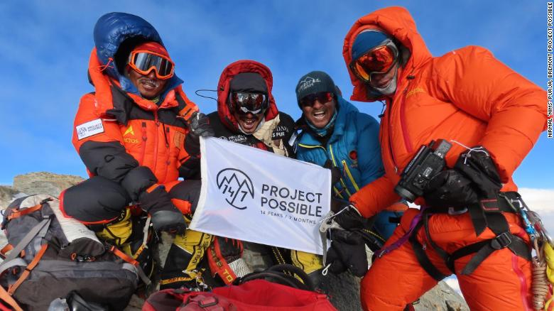 Purja at the summit of Dhaulagiri with members of his team.