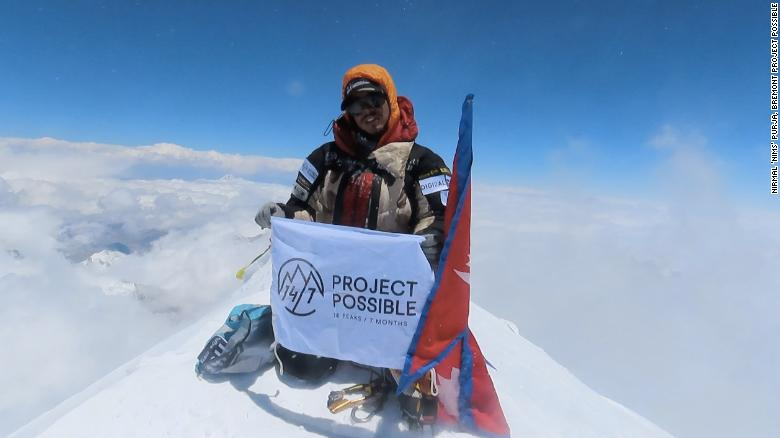 Purja at the summit of the 8,586-meter-tall Kanchenjunga, the world's third highest mountain.
