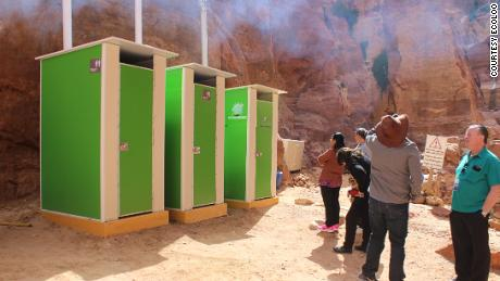 Tourists queue outside EcoLoo cubicles at Petra, Jordan. The UNESCO World Heritage acquired the units in 2016, with local media reporting that fertilizer produced by the toilets was used in plant nurseries.