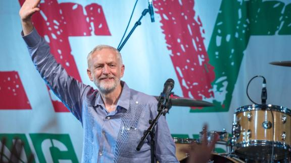 GLASTONBURY, ENGLAND - JUNE 24:  Labour Party leader Jeremy Corbyn speaks to crowds at Left Field Stage at Glastonbury Festival Site on June 24, 2017 in Glastonbury, England. Labour Party leader Jeremy Corbyn addressed crowds at Glastonbury at both the Pyramid Stage and Left Field Stage. During the 2017 General Election Mr Corbyn surprised many as he made significant gains with his party, partially due to galvanising young voters when 61.5% of under 40