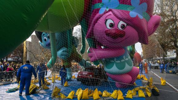 The Trolls balloon is kept under a net during Wednesday's inflation process in New York.