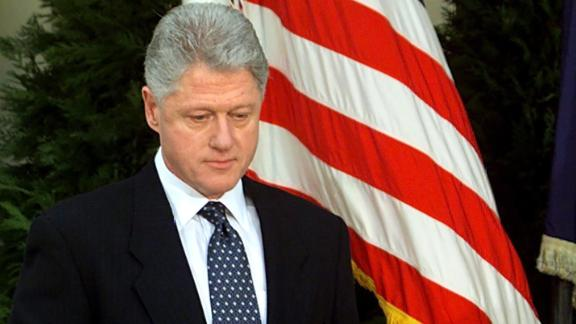 """WASHINGTON, :  US President Bill Clinton walks to the podium moments before reading a statement in the Rose Garden of the White House after the Senate voted not to impeach him 12 February in Washington, DC. Clinton apologized for the actions that led to his impeachment and subsequent acquittal by the Senate, saying he was """"profoundly sorry."""""""