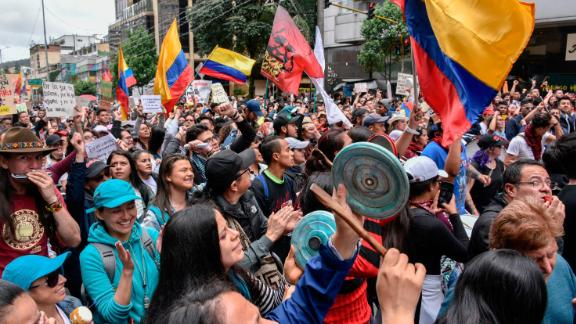 Anti-government demonstrators wave Colombian flags during protests and national strike against government of President Iván Duque on November 27, 2019 in Bogota, Colombia.