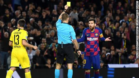 Messi receives a yellow card for diving on an historic night for the Argentine.
