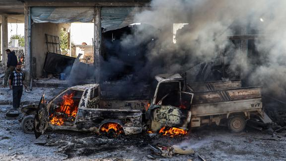 A car burns following a car bomb explosion in Tal Abyad, a city in northern Syria near the Turkey border, on Saturday, November 23.