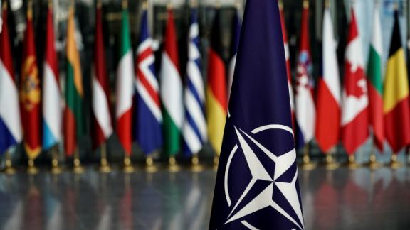 November 20, 2019 shows a NATO flag at the NATO headquarters in Brussels (Photo by KENZO TRIBOUILLARD/AFP via Getty Images)