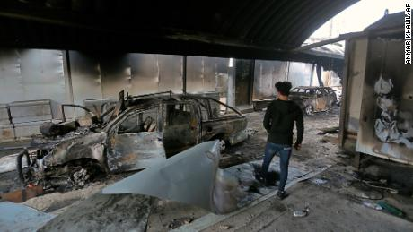 A man inspects the inside of the burned Iranian consulate in Najaf, Iraq, Thursday, Nov. 28, 2019. An Iraqi police official says anti-government protesters have burned down the Iranian consulate in southern Iraq late Wednesday. Protesters torched the Iranian consulate building in the holy city of Najaf, the seat of the country's Shiite religious authority. Iranian staff working in the consulate escaped through the back door and were not harmed. (AP Photo/Anmar Khalil)