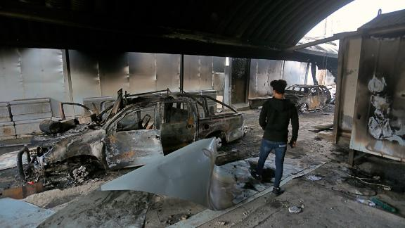 A man inspects the inside of the burned Iranian consulate in Najaf, Iraq, Thursday, Nov. 28, 2019. An Iraqi police official says anti-government protesters have burned down the Iranian consulate in southern Iraq late Wednesday. Protesters torched the Iranian consulate building in the holy city of Najaf, the seat of the country