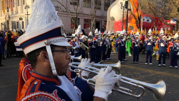 James Leach plays the trumpet as parade participants assemble at the start.