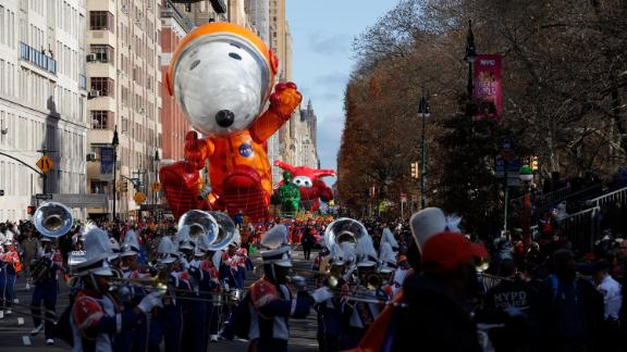 Astronaut Snoopy makes its way down New York's Central Park West.