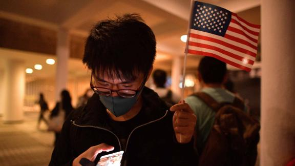 A pro-democracy protester holds up a US flag during a gathering of thanks at Edinburgh Place in Hong Kong's Central district.