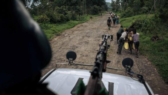A UN peacekeeper patrols in DRC
