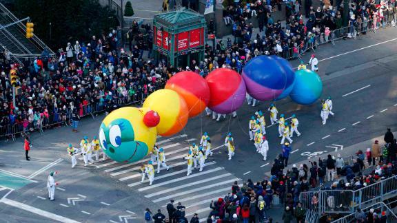 A colorful caterpillar balloon floats during the parade.