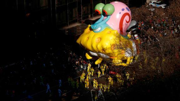 "A ""SpongeBob SquarePants"" balloon catches a beam of light."