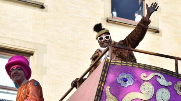 Entertainer Billy Porter rides one of the floats.