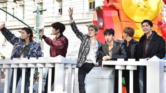 Boy band NCT 127 waves to fans.